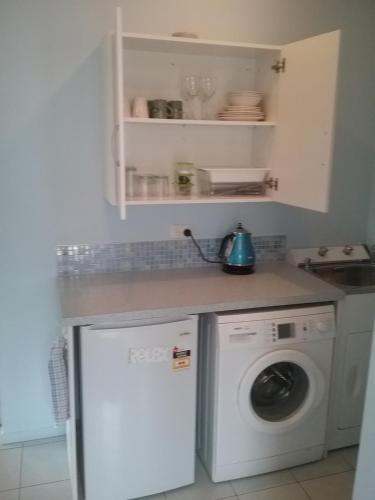 A kitchen or kitchenette at Sandcastle BnB