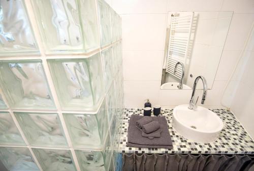 Een badkamer bij Museumhuisje 013