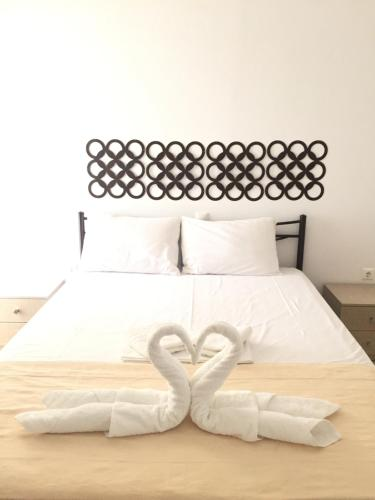 A bed or beds in a room at Vila Kosteli