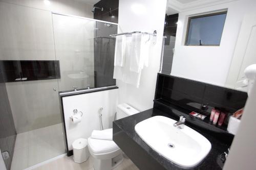 Um banheiro em Hotel Bhally