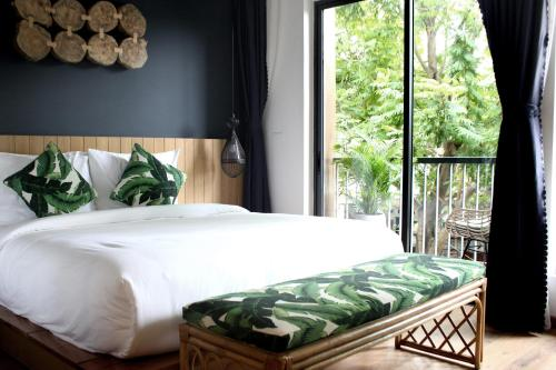 A bed or beds in a room at Moc Lan Boutique Hotel