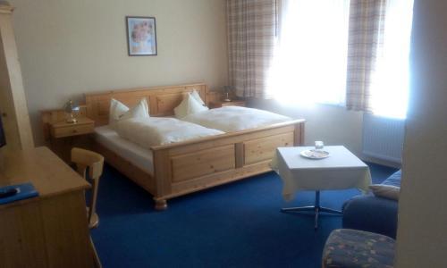 Ein Bett oder Betten in einem Zimmer der Unterkunft Harz Resort Waldesruh