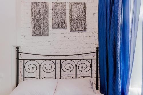 Кровать или кровати в номере Studio Nekrasova 1