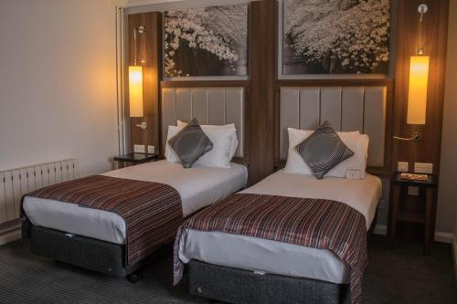 A bed or beds in a room at Mercure Darlington King's Hotel