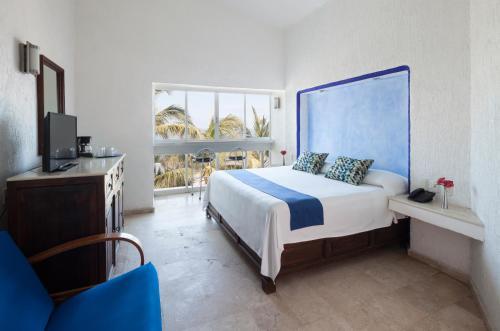 A bed or beds in a room at Hotel Villa Varadero