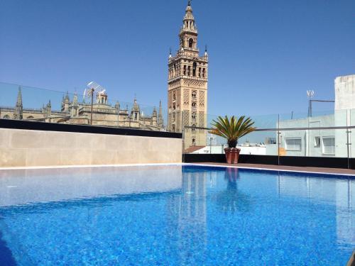 The swimming pool at or near Hotel Casa 1800 Sevilla