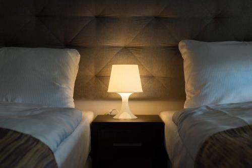 A bed or beds in a room at City Rooms Szczecin