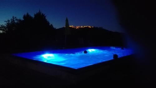 The swimming pool at or near Quinta Do Vaqueirinho - Agro-Turismo