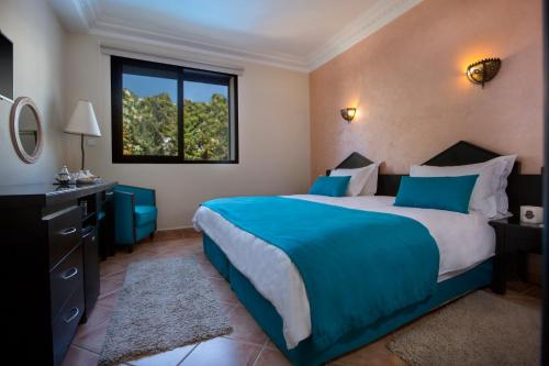 A bed or beds in a room at Atlantic Hotel Agadir