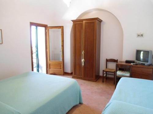 Letto o letti in una camera di Le Ghiande