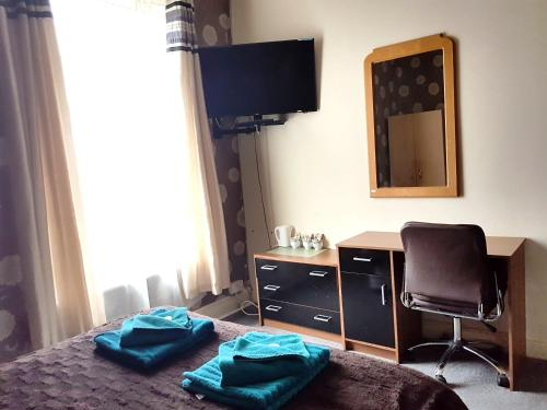 A television and/or entertainment center at Amber Guesthouse