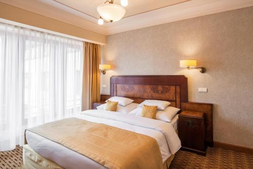 A bed or beds in a room at Majestic Plaza Hotel Prague