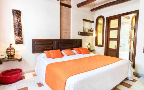A bed or beds in a room at Casa de Federico Boutique