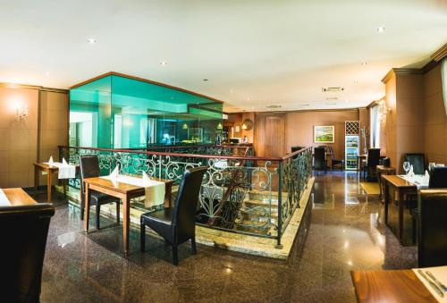 A restaurant or other place to eat at Ventura Boutique Hotel