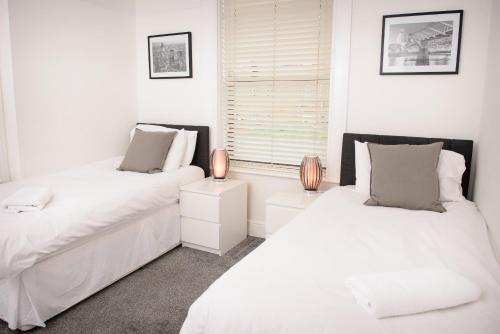 A bed or beds in a room at The Claremont