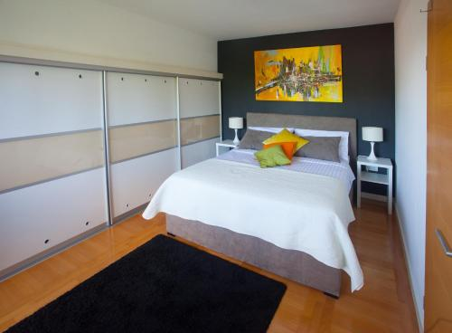 A bed or beds in a room at Apartment Sladic