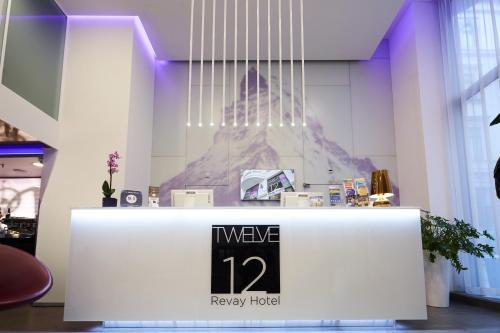 The lobby or reception area at 12 Revay Hotel