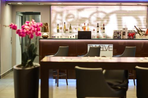 A restaurant or other place to eat at 12 Revay Hotel