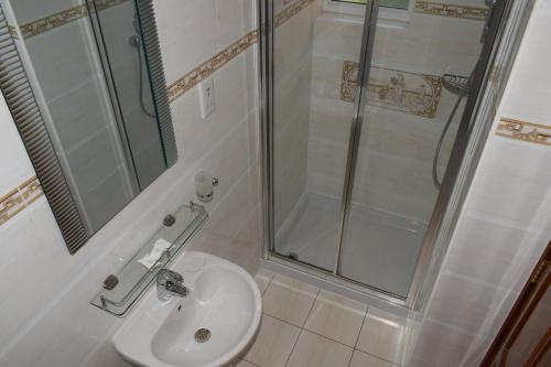 A bathroom at Leigham Court Hotel