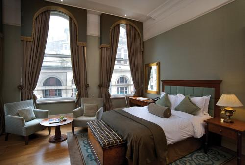 A bed or beds in a room at Quebecs