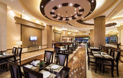 Um restaurante ou outro lugar para comer em Boudl Buraydah