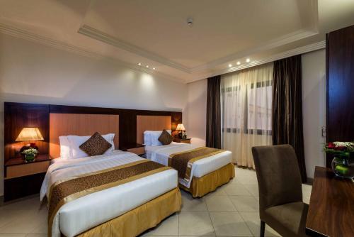 سرير أو أسرّة في غرفة في بودل الرس