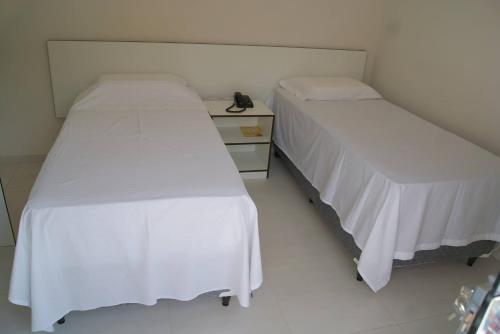 Cama ou camas em um quarto em Hotel Nardy