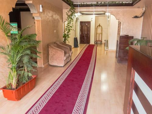 O saguão ou recepção de Kasr Dama Furnished Apartments