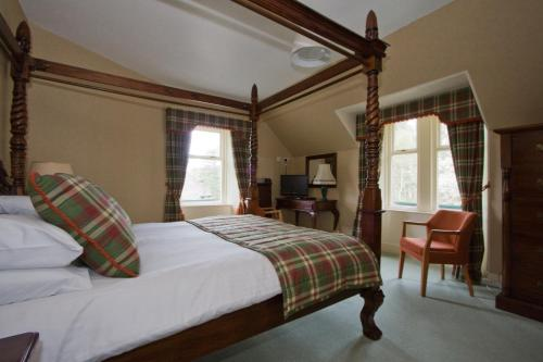 A bed or beds in a room at Loch Kinord Hotel