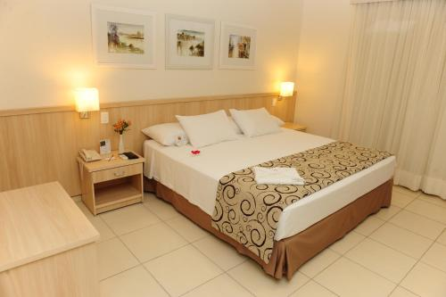 A bed or beds in a room at Saint Peter Hotel São Jose do Rio Preto