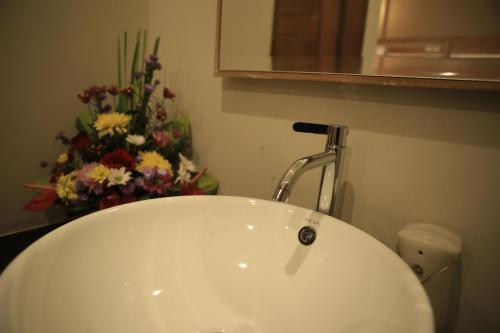 Ein Badezimmer in der Unterkunft Poshtel Ubud