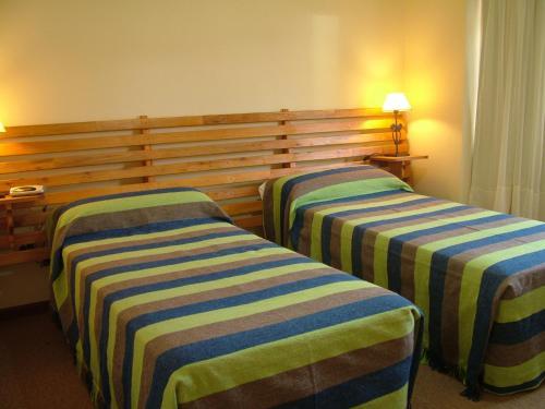 Una cama o camas en una habitación de Posada Karut Josh