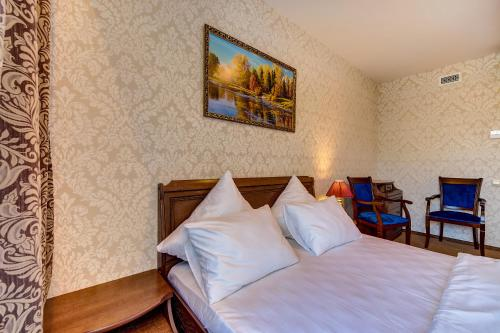 Кровать или кровати в номере Отель Shouyuan