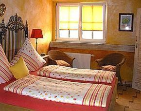 Ein Bett oder Betten in einem Zimmer der Unterkunft Haus Silbermond
