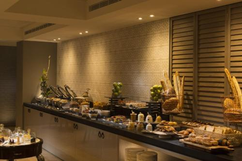 A restaurant or other place to eat at Mayfair Hotel