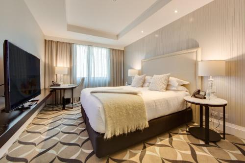 A bed or beds in a room at Mayfair Hotel