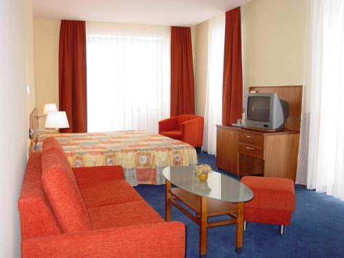 Кровать или кровати в номере Hotel Filipinum