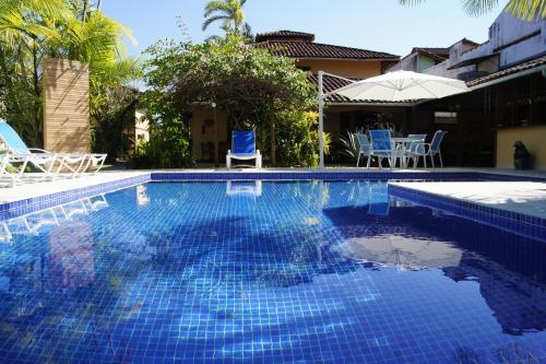 The swimming pool at or near Pousada Paisagem