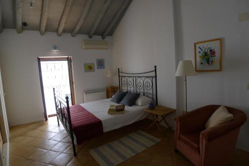 A bed or beds in a room at Salvatierra Guest House
