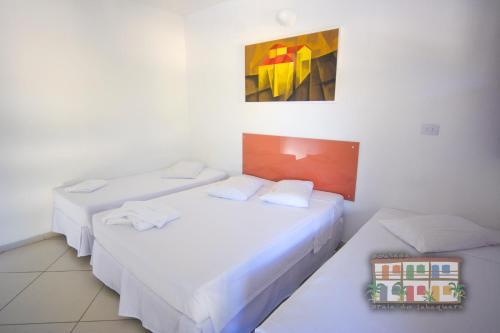 Cama ou camas em um quarto em Pousada Praia do Jabaquara