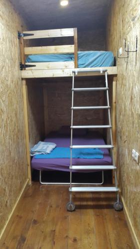 Letto o letti a castello in una camera di Casa Rosa