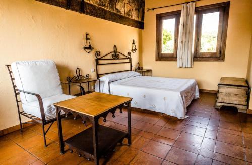 Кровать или кровати в номере Hotel Rural Hosteria Fontivieja