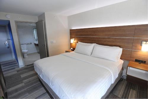 A bed or beds in a room at Holiday Inn Express & Suites Toronto Airport West, an IHG Hotel