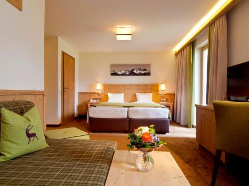 A bed or beds in a room at Landhotel Lechner