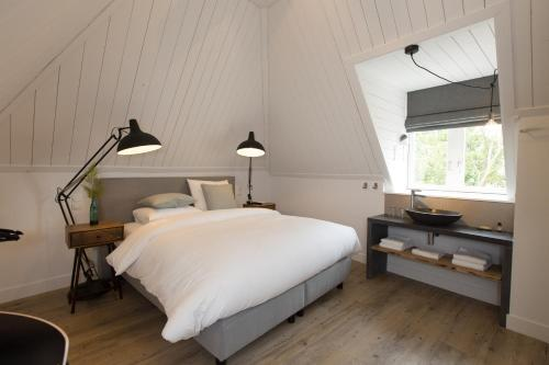A bed or beds in a room at Eye Hotel