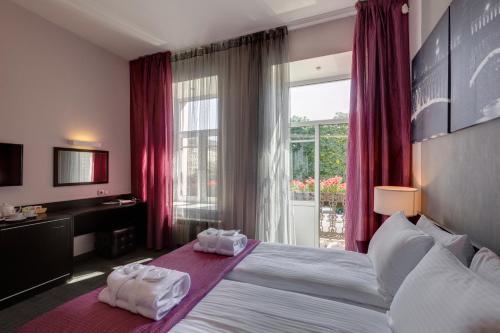 Кровать или кровати в номере Отель Мари