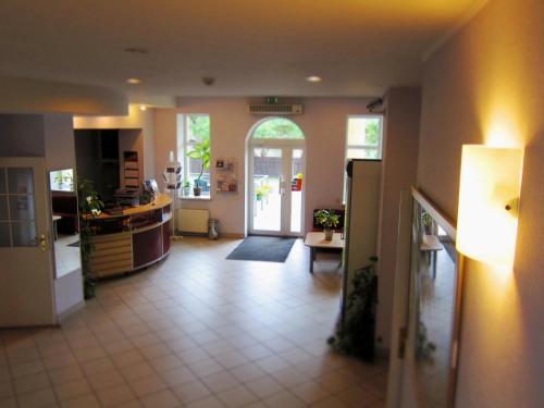 The lobby or reception area at Hotel Vilmaja
