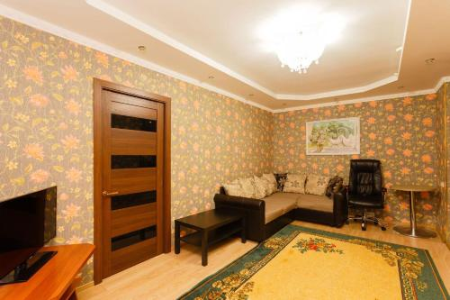 Гостиная зона в Business Brusnika Comfort Class Apartment Nagornaya