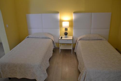 A bed or beds in a room at Alcamim Guesthouse