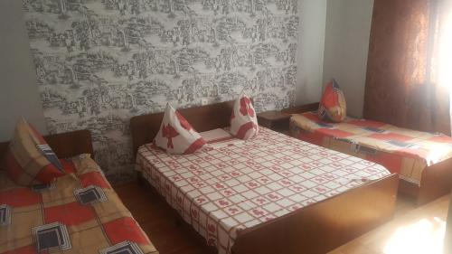 A bed or beds in a room at Guest house on Sosnalieva 12